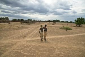 DSC_4266, Omo Village, Ethiopia, 8/2013, ETHIOPIA-10231. Two boys walk together. retouched_Kate Daigneault 08/26/13